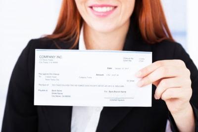 Woman holding paycheck