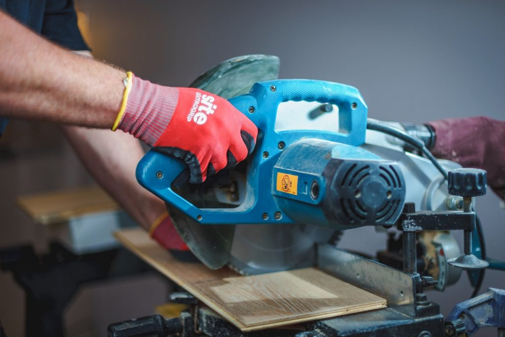 Home contractor with saw cutting wood.